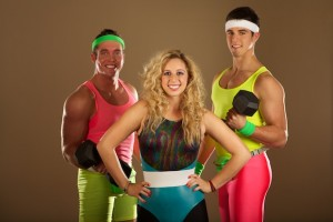 Gym fashion of the 1980s includes neon colors and legwarmers.